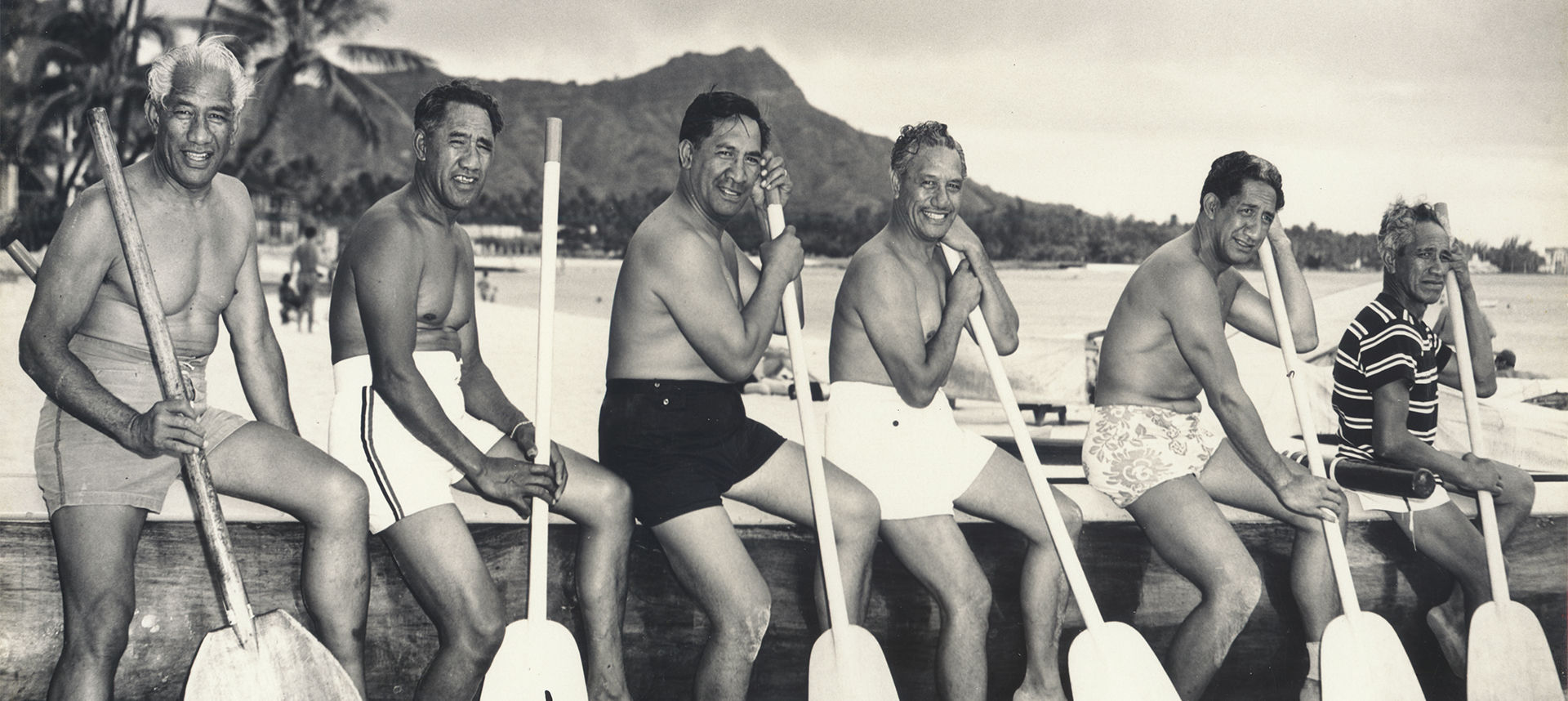 Duke and other men near the water with oars